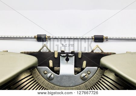 Close-up of word Life on typewriter sheet