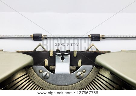 Close-up of word Security on typewriter sheet