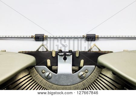 Close-up of word No on typewriter sheet
