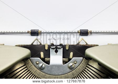 Close-up of word Solution on typewriter sheet