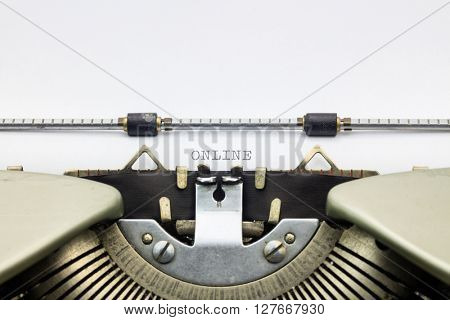 Close-up of word Online on typewriter sheet