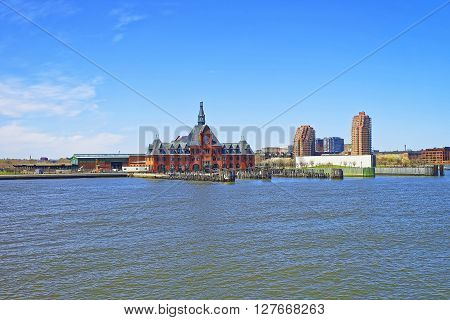 New York, USA - April 25, 2015: Central Railroad of New Jersey Terminal in USA. Hudson Waterfront. The Hudson River. Ferry slips serving boats.