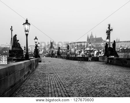 Charles Bridge and Prague Castle in the morning, Prague, Czech Republic. Black and white image.