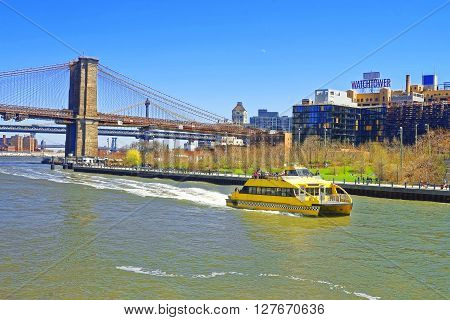 Ferry Boat And Brooklyn Bridge Over East River