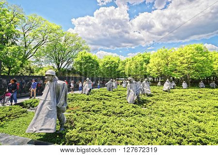Washington DC USA - May 2 2015: Tourists and War Veterans and guardians of Honor Flight nonprofit organization in Korean War Veterans Memorial in West Potomac Park National Mall.