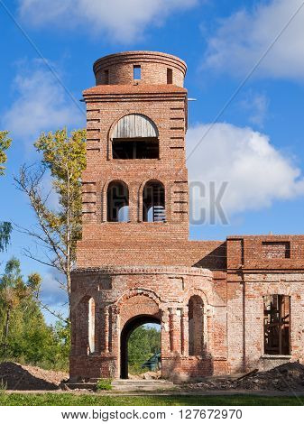 The ruins of the old church built of brick. Photo taken on a sunny day