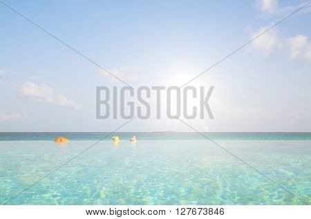 Infinity Pool in Maldives Travel Destination Concept