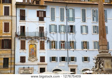 ROME, ITALY - APRIL 8, 2016: House at the Pantheon square and fountain