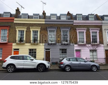 LONDON - APRIL 25: Multicoloured Terraced Houses on April 25, 2016 in Camden, London, UK.