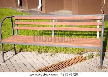 wooden bench on a dwelling house, nobody