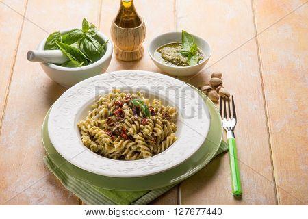 pasta with pesto pistachio and dried tomato