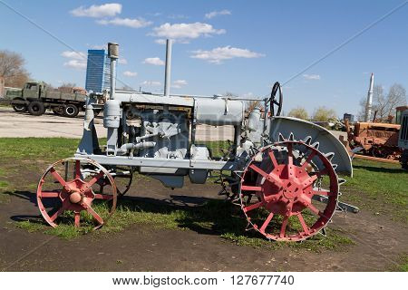 Old Soviet Tractor With Metal Wheels.