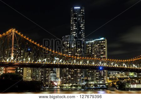 BRISBANE, AUSTRALIA - MARCH 3 2016: Brisbane Story Bridge and cityscape closeup by night, view from the New Farm Riverwalk