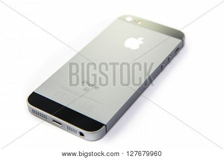 PARIS FRANCE - APR 21 2016: Rear view of the new Apple iPhone SE combining the updated processor 4K rear camera touch id retina display