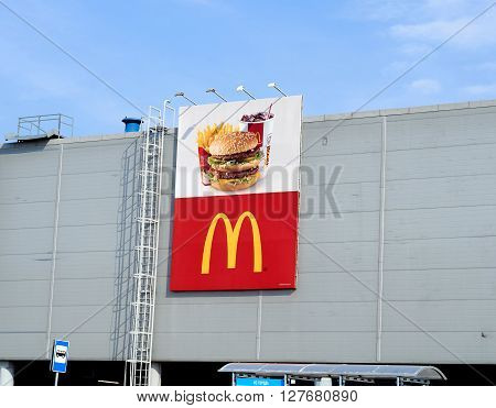 Mcdonald's Logo On Wall Of Shopping Center.