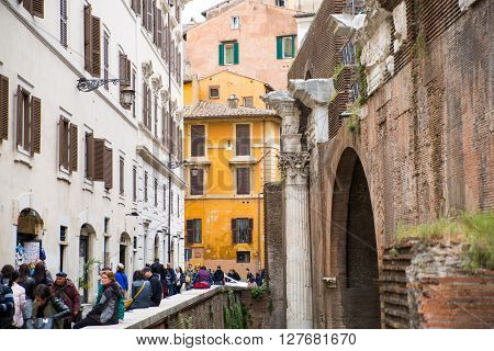 ROME, ITALY - APRIL 8, 2016: Pantheon old walls and side street with lots of people