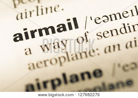Close Up Of Old English Dictionary Page With Word Airmail.