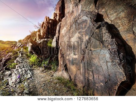 Petroglyph With Animals At Sunset