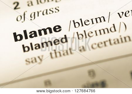 Close Up Of Old English Dictionary Page With Word Blame.
