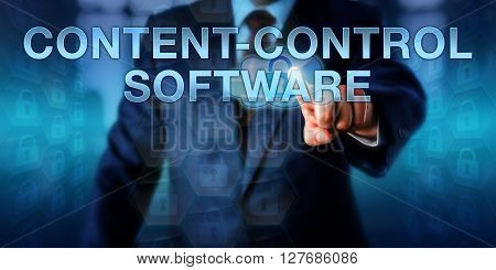 Manager is pressing CONTENT-CONTROL SOFTWARE on an interactive touch screen interface. Information technology and internet security concept for programs restricting readers to authorized content.