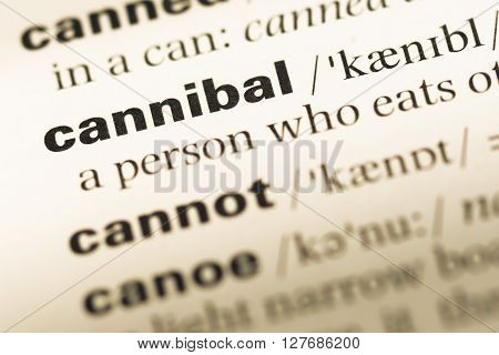Close Up Of Old English Dictionary Page With Word Cannibal.