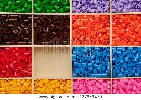 Colorful fusible plastic beads background with copyspace