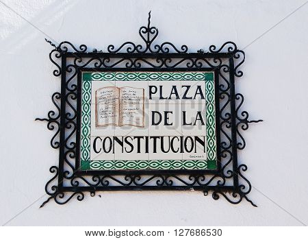 MIJAS, SPAIN - JUNE 14, 2008 - Constitution Square name plaque on the wall (Plaza de la Constitucion) Mijas Malaga Province Andalucia Spain Western Europe, June 14, 2008.
