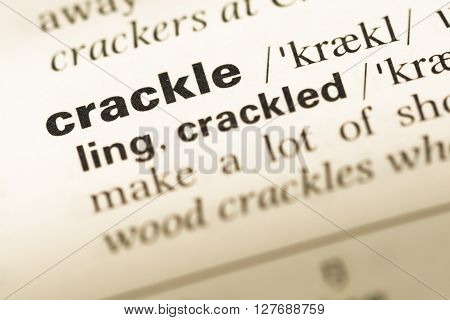 Close Up Of Old English Dictionary Page With Word Crackle.