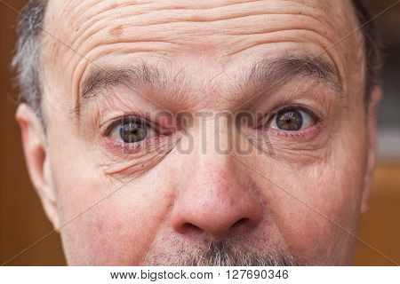 older man's eyes widened in surprise and shock