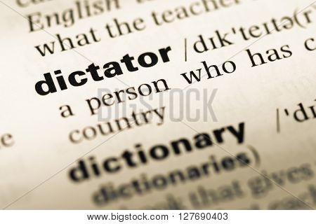 Close Up Of Old English Dictionary Page With Word Dictator.