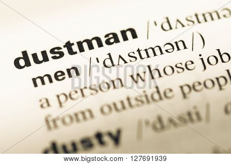 Close Up Of Old English Dictionary Page With Word Dustman.