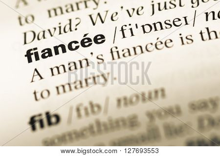 Close Up Of Old English Dictionary Page With Word Fiancee.