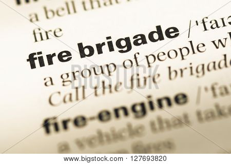 Close Up Of Old English Dictionary Page With Word Fire Brigade.