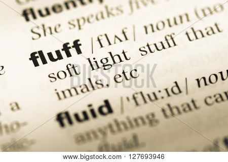Close Up Of Old English Dictionary Page With Word Fluff.
