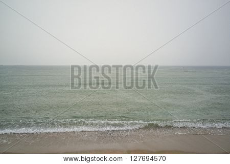 Rain falls over the sea on a rainy day ** Note: Visible grain at 100%, best at smaller sizes