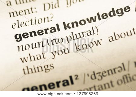 Close Up Of Old English Dictionary Page With Word General Knowledge.