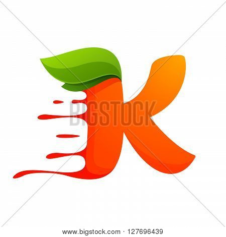 K Letter With Orange Juice Drops And Leaves.