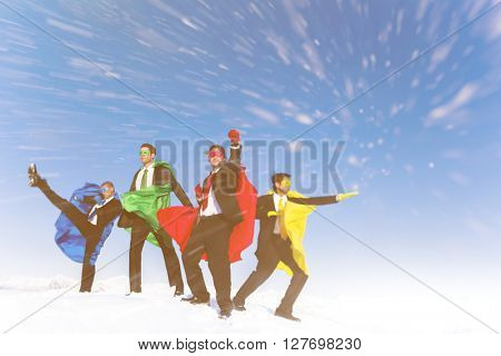 Business superheros posing fighting moves in blizzard