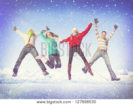 Group of friends jumping in the snow.