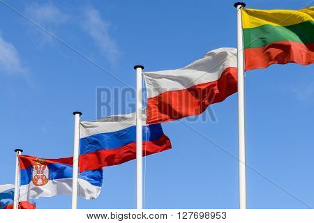Flag of Russia Poland and Lithuania on the background of the sky