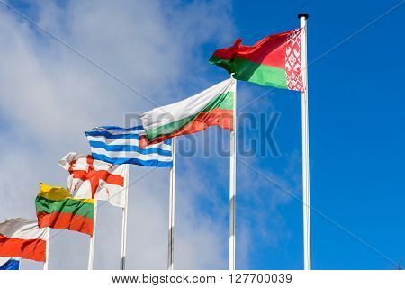 Flag of the Republic of Belarus and foreign countries against the blue sky