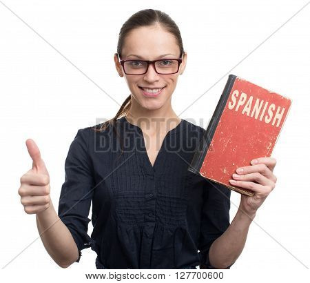 Young Woman Holding Spanish Textbook