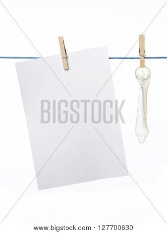 Condom on a washing line with blank paper