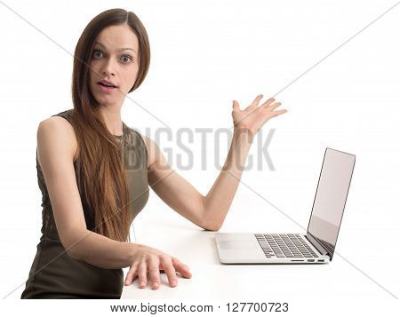 Puzzled Young Woman With Laptop