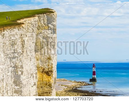 White chalk cliffs and Beachy Head Lighthouse. Eastbourne East Sussex England