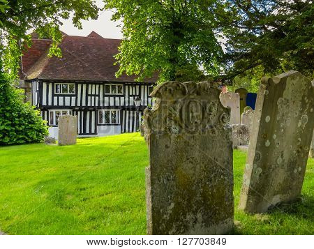 Old house and ancient tombstones in rural England