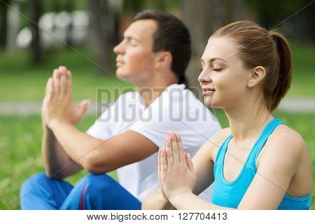 Having yoga practice in park