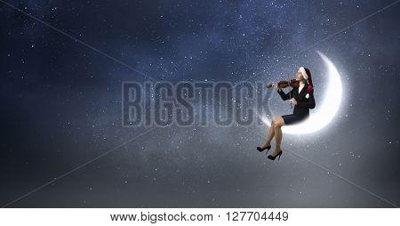 Santa woman play violin
