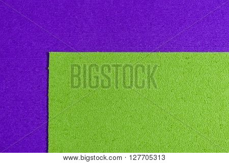 Eva foam ethylene vinyl acetate apple green surface on purple sponge plush background