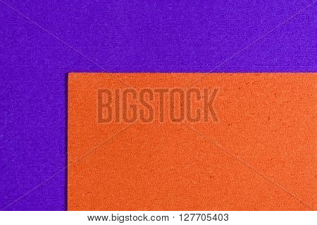 Eva foam ethylene vinyl acetate orange surface on purple sponge plush background